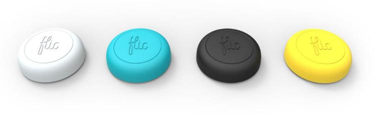 Foto som visar fyra Flic-knappar på en vit bakgrund. Knapparna har olika färg: vit, blå, svart och gul.