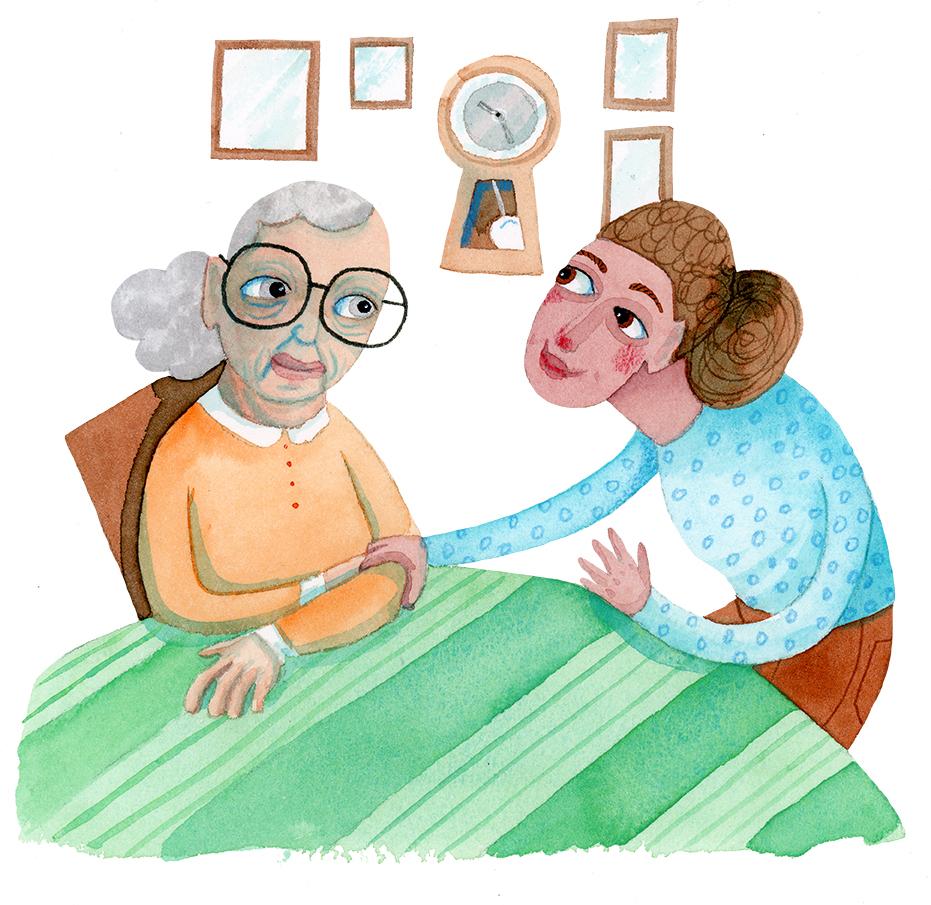 En kvinna i orange tröja sitter vid ett bord, Hemtjänsten tar henne lätt i armen och pratar med henne i ögonhöjd.