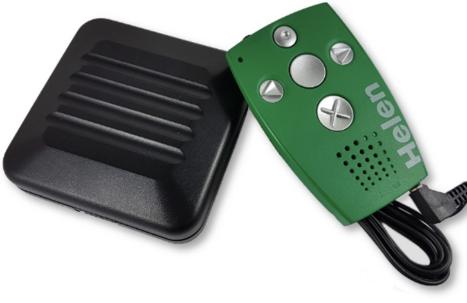 En grön enhet med 5 knappar samt en lite större svart vibrator.