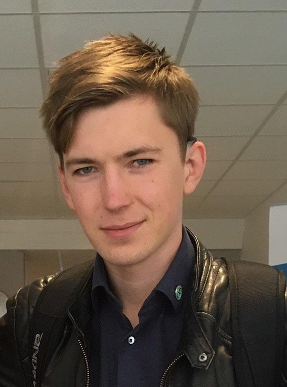 Porträtt Kristofer som har brunt hår.